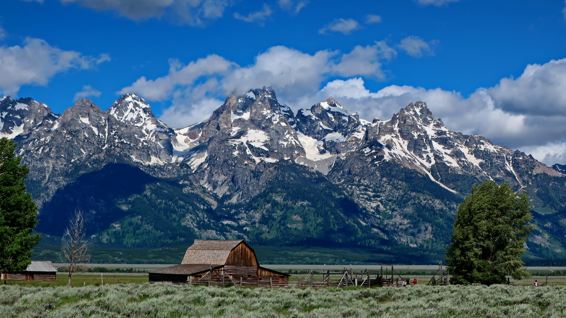 Mormon Ranch with Tetons seen from the street to the campsite on foot of Shadow Mountain