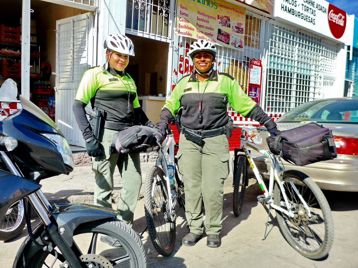 Policewomen with their bicycles