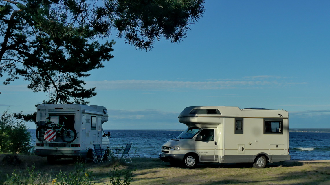 Two Karmann Volkswagen on shore of lake Vättern - Elli and Roland's van on the right