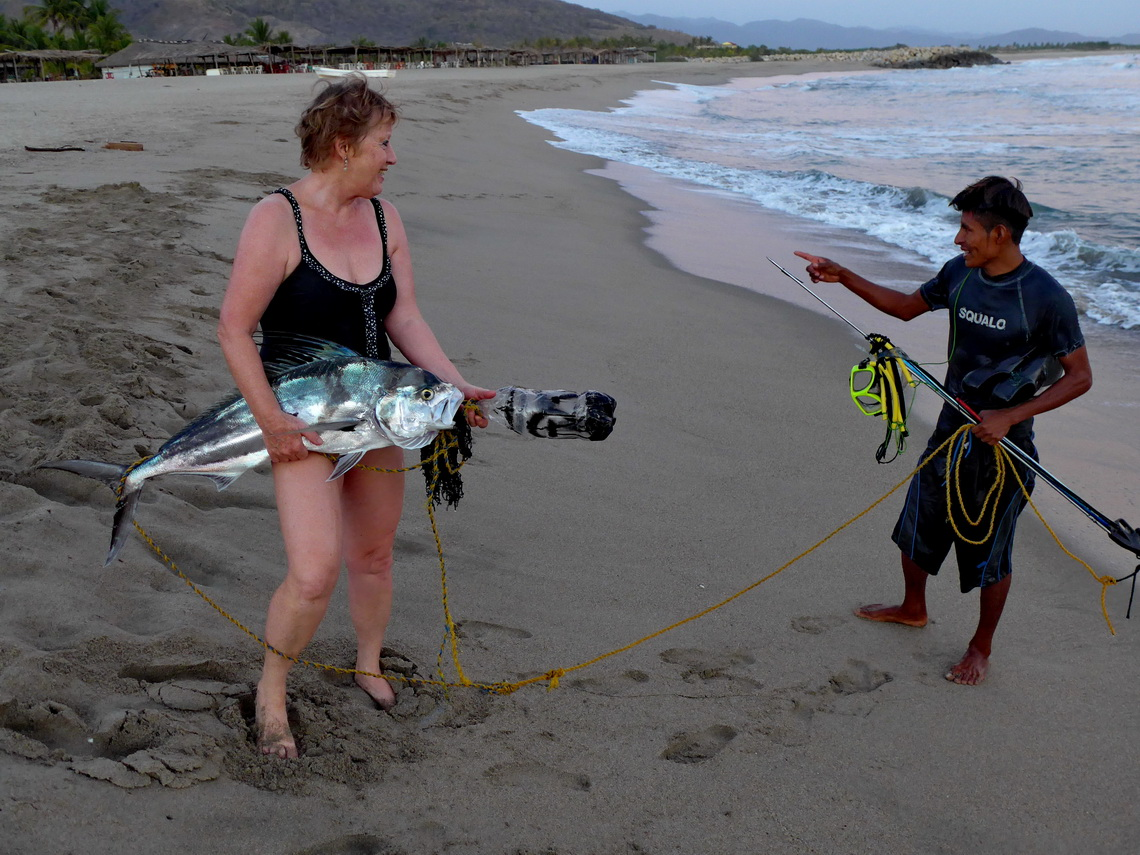 Marion with a big fish and his hunter on Playa Cerro Hermoso