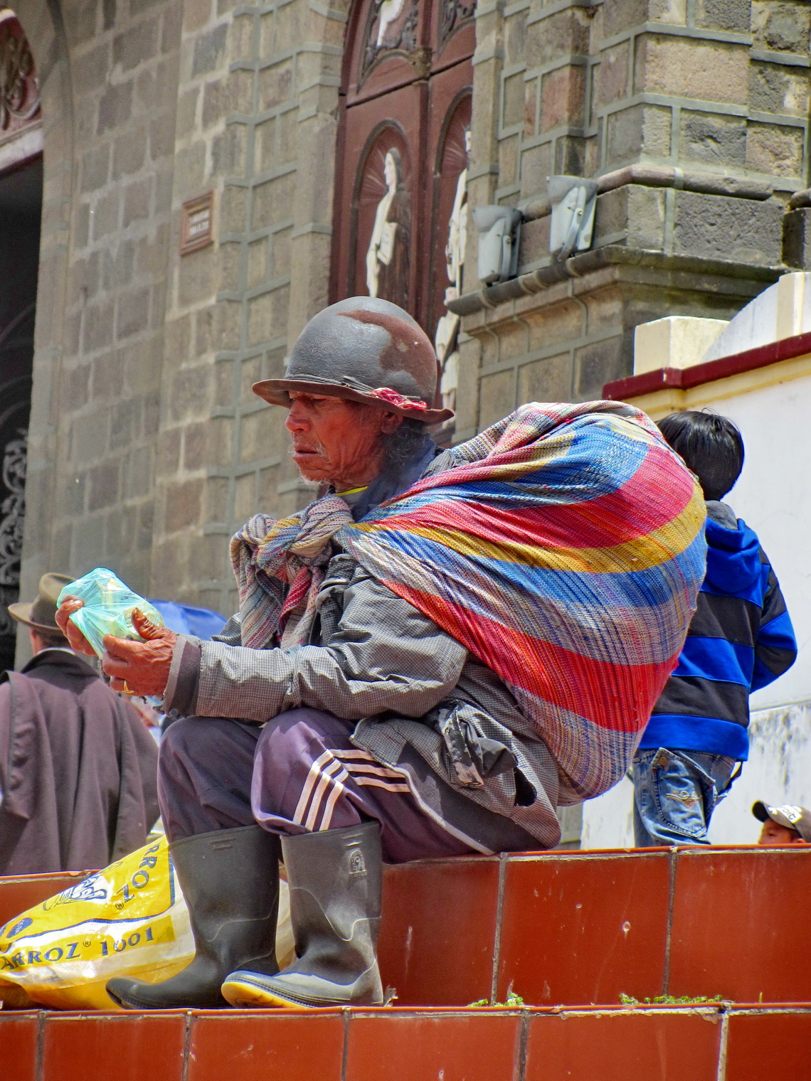Man in front of the main church of Cotacachi
