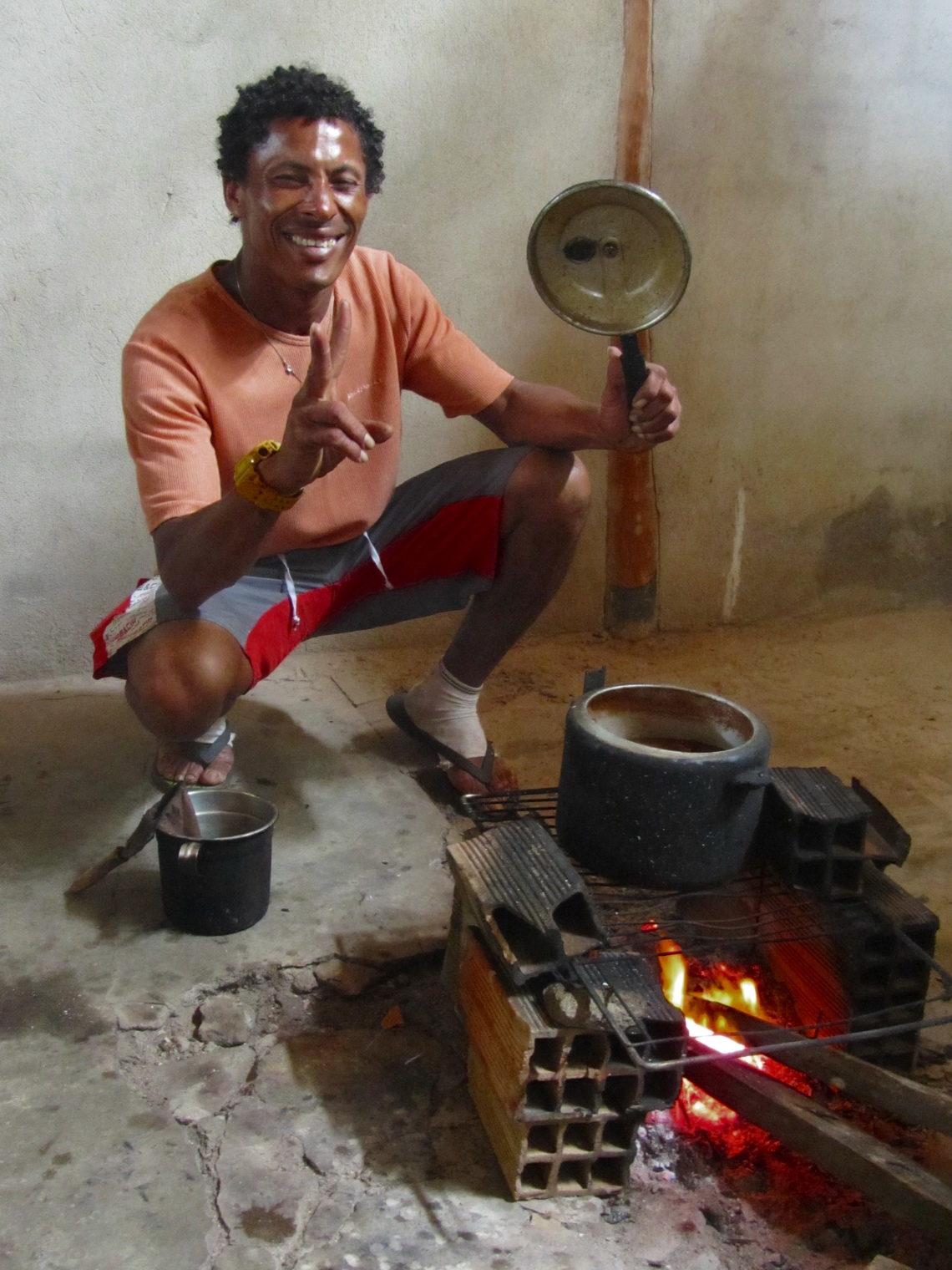 Our proud chef showing the delicious chicken stew on his stove