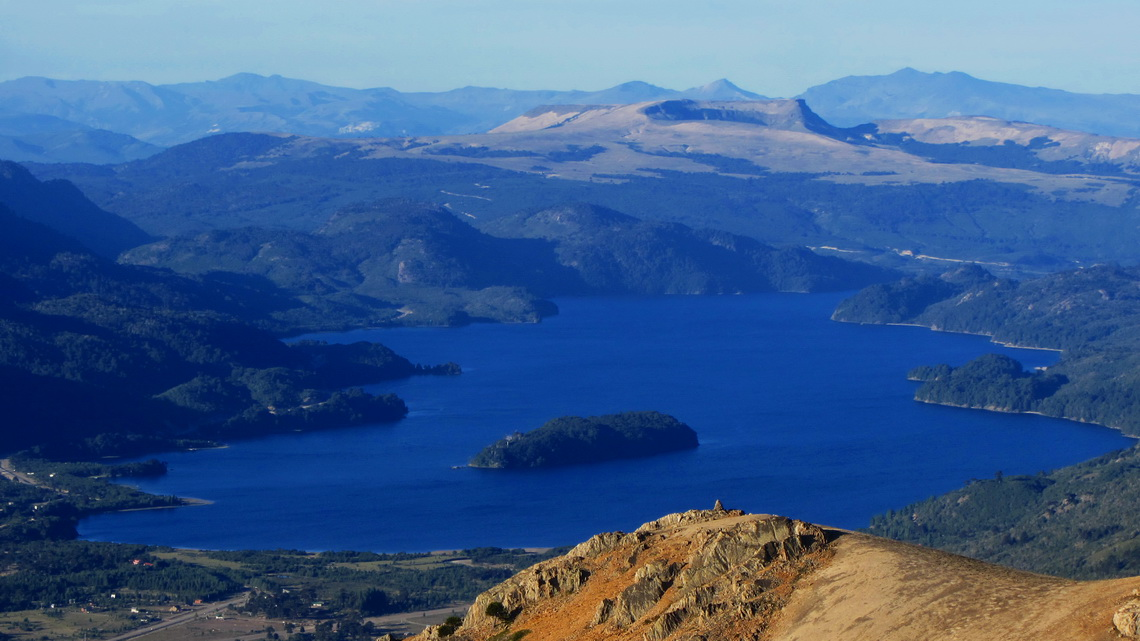 Blue Lago Moquehue and brown Volcan Batea Mahuida in the back of the lake