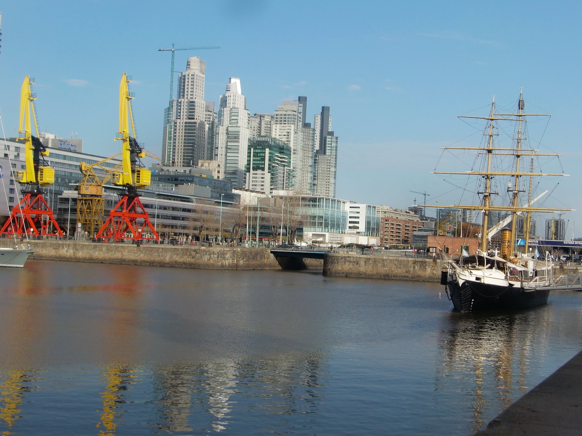 One of the channels of Puerto Madero with an ancient vessel
