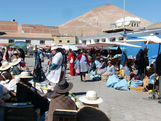 Street market in Potosi with Cerro Rico in the background