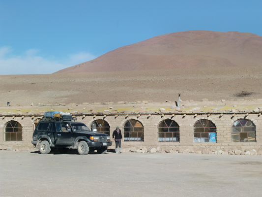 Our hostel at the Laguna Colorada with our Toyota Landcruiser