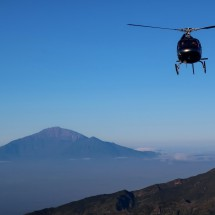 Approaching helicopter with Mount Meru