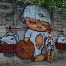 Alfred with a mural in Bangkok's Chinatown