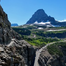 Path through the rocks with Logan Pass (left)