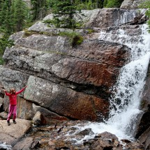Rosemarie with a waterfall close to Lake Agnes