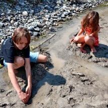 Kids playing in the mud of Kicking Horse River