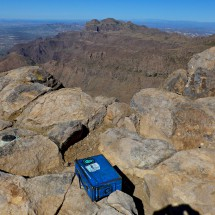 Summit of 1541 meters high Superstition Peak with Ridgeline and Flatiron in the background
