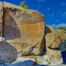 Alfred with petroglyphs in the Tsankawi prehistoric site of the Bandelier National Monument