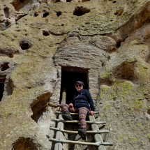 Marion in front of a cave house in the Frijoles Canyon in the Bandelier Natonal Monument
