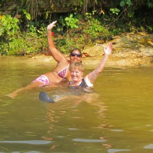 Brazilian and German girl enjoying the fresh water of the Parque Nacional da Chapada dos Guimaraes