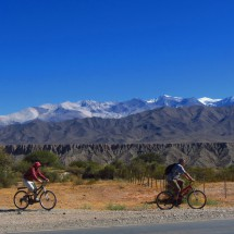 Bicycling down to Cachi with the snowy mountains Nevados de Cachi in the background