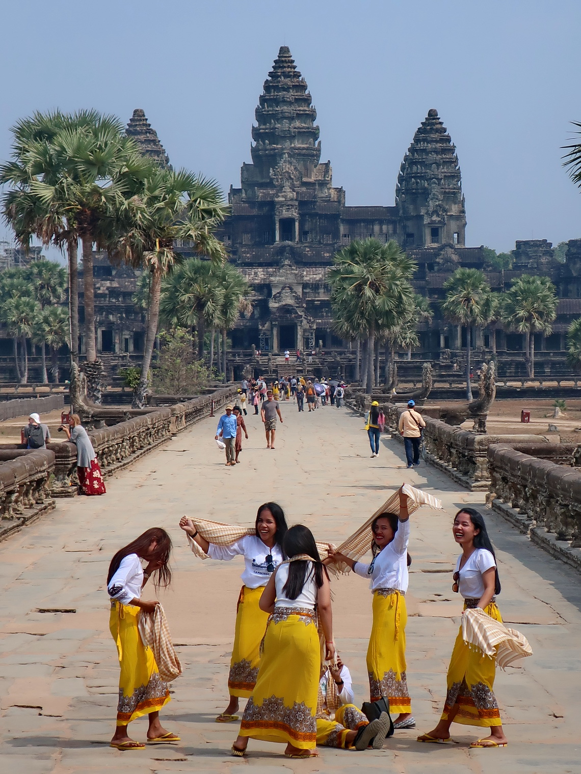 Cambodian girls with Angkor Wat