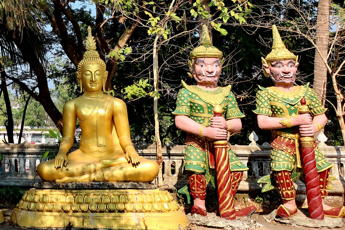 Buddha with two Guards close to Wat That Kuang