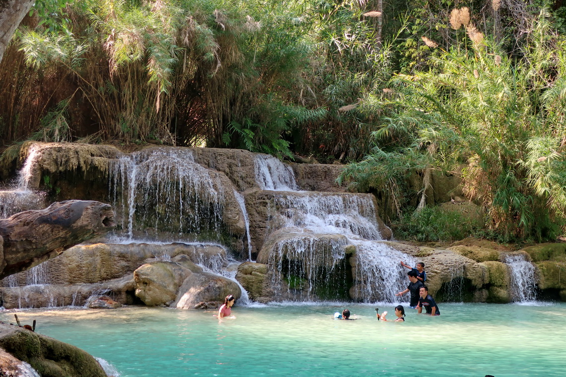 Swimming below Kuang Si Waterfalls