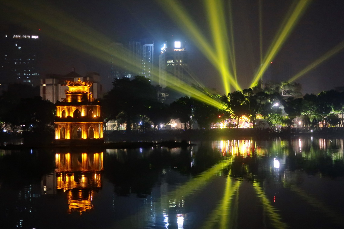 Laser show on Hoan Kiem Lake with Turtle Tower