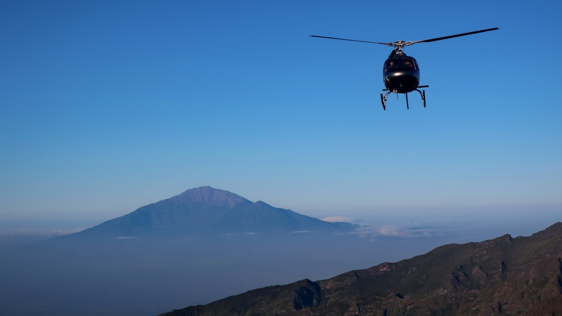 Approaching helicopter with Mount Meru on Shira Cave Camp