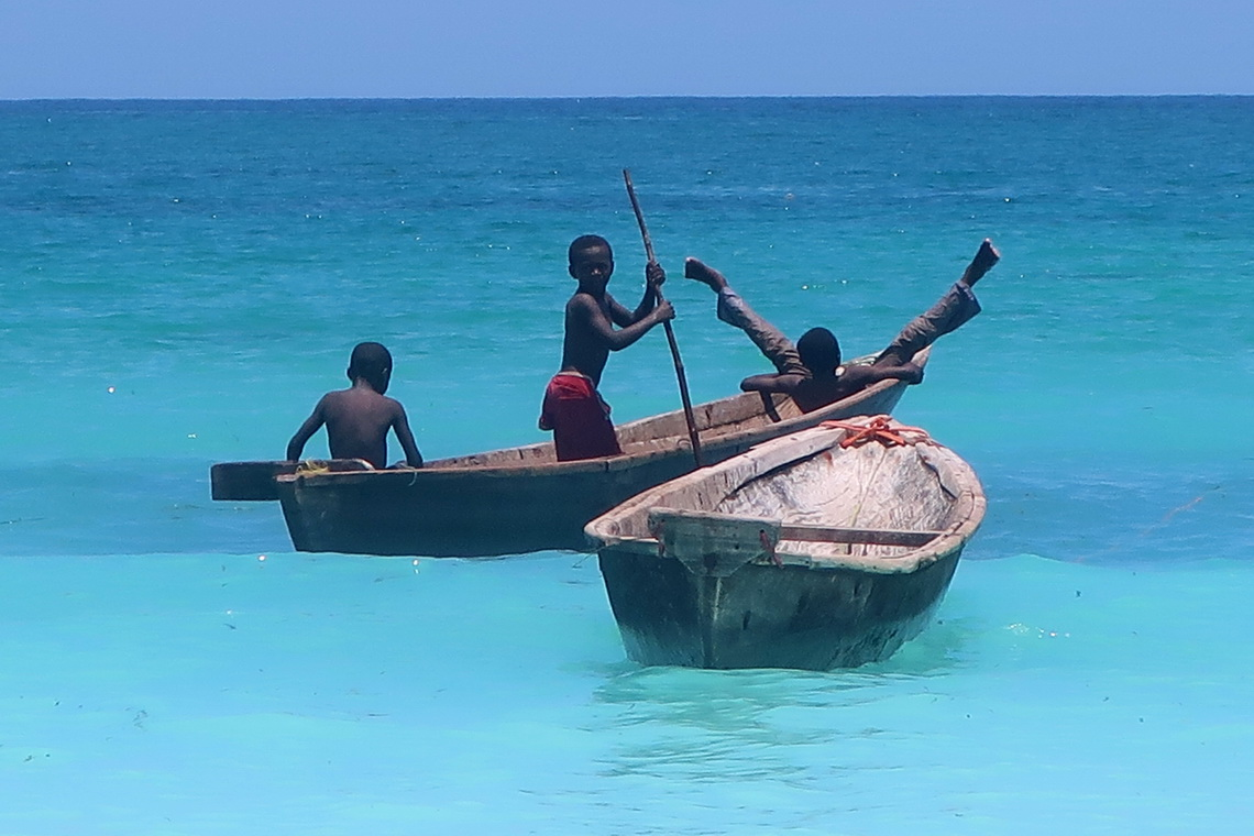Boys playing in a little boat