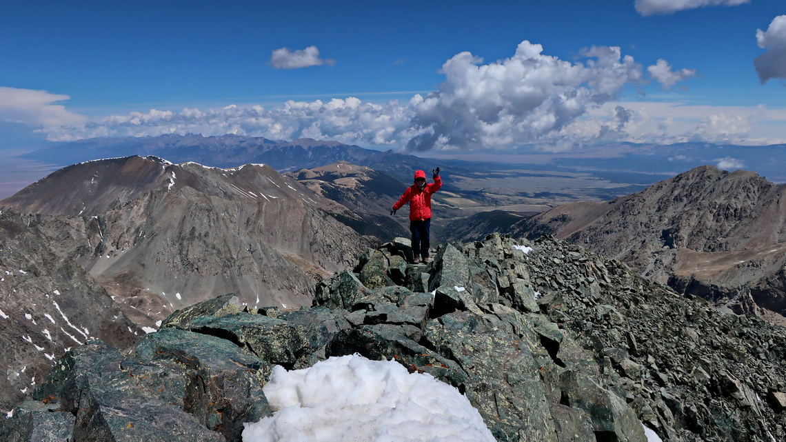 Marion is arriving on the summit of Blanca Peak