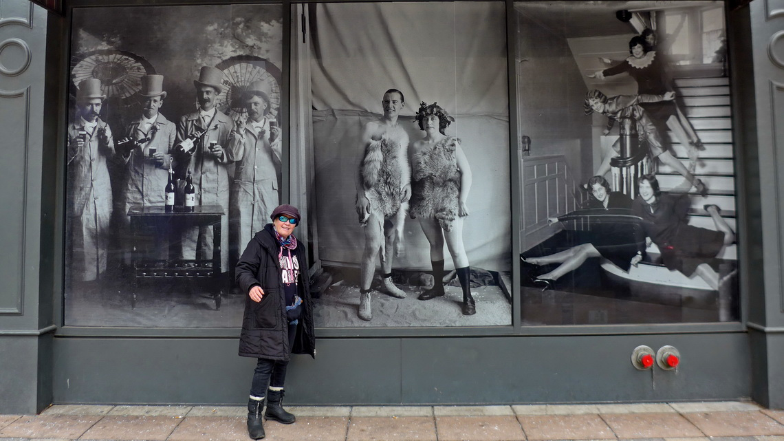 Marion with ancient pictures in the 16th Street Mall of Denver