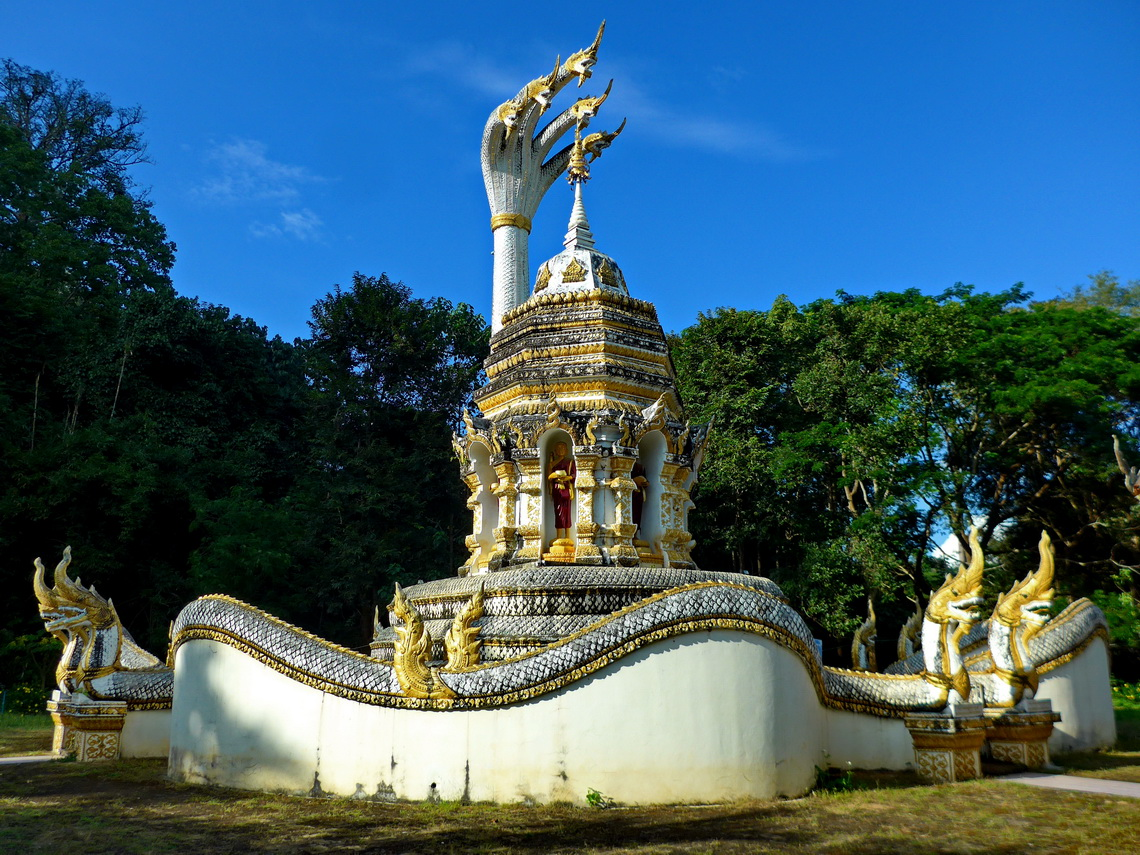 One of the many temples of the Wat Tham complex