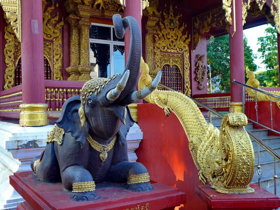 Elephant watching the entrance of the temple Wat Chedi Ngam in Fang