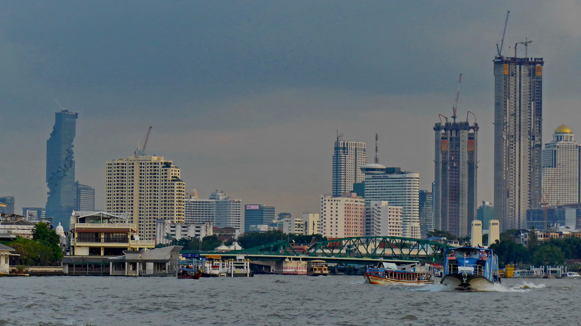 Skyline of Bangkok seen from the public boat on Chao Pram River