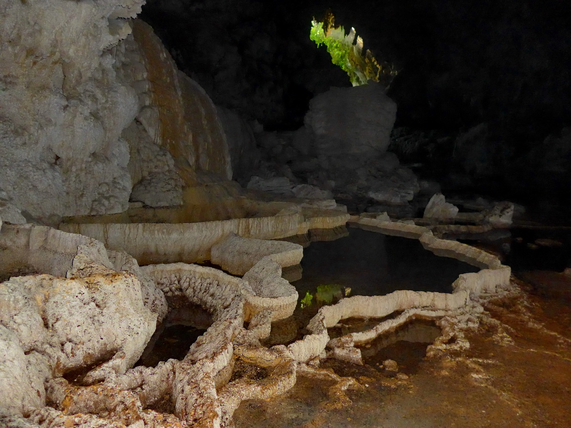 Basins in the cave with its entrance