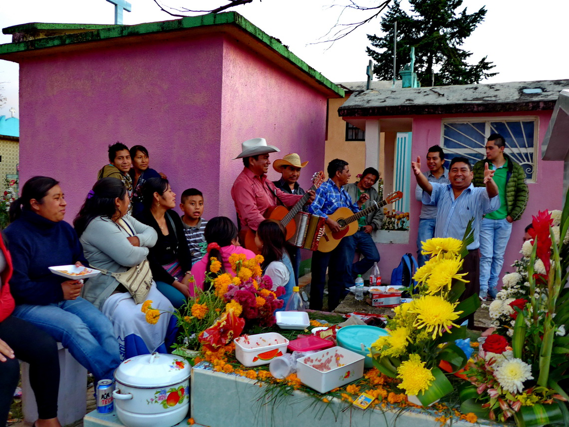 Typical Mexican All Soul's Day celebration on the cemetery