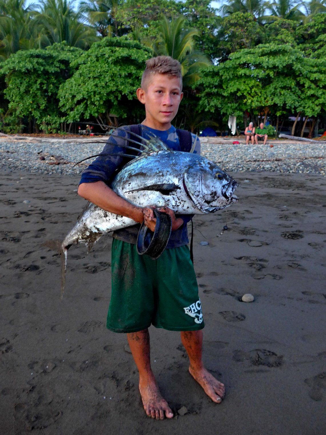 Proud boy on Playa Dominical - He fought more than half an hour to get this big fish