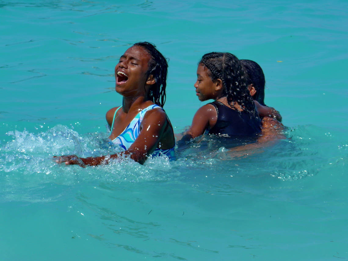 Girls enjoying the warm water of the Caribbean Sea