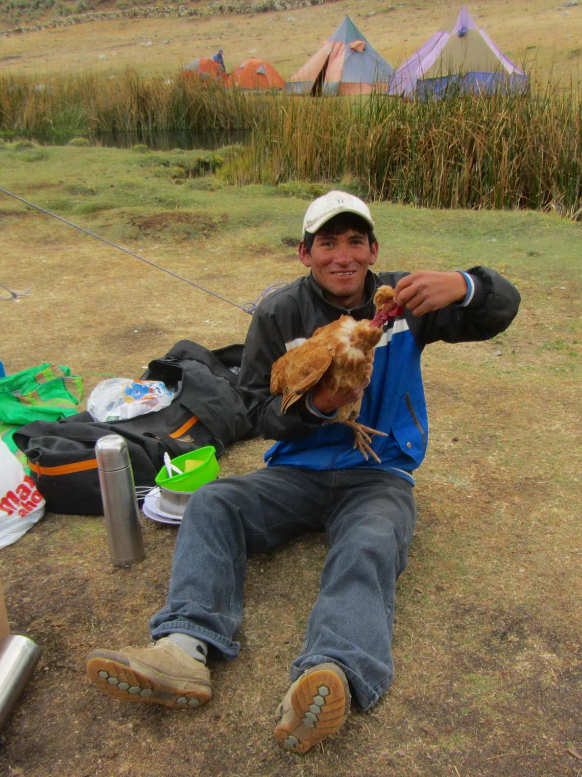 Susman with a chicken in the Jahuacocha camp