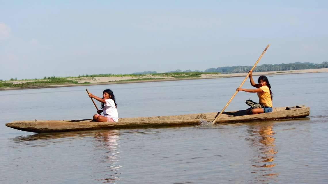 Two Ladies in a logboat on huge Rio Ucayali