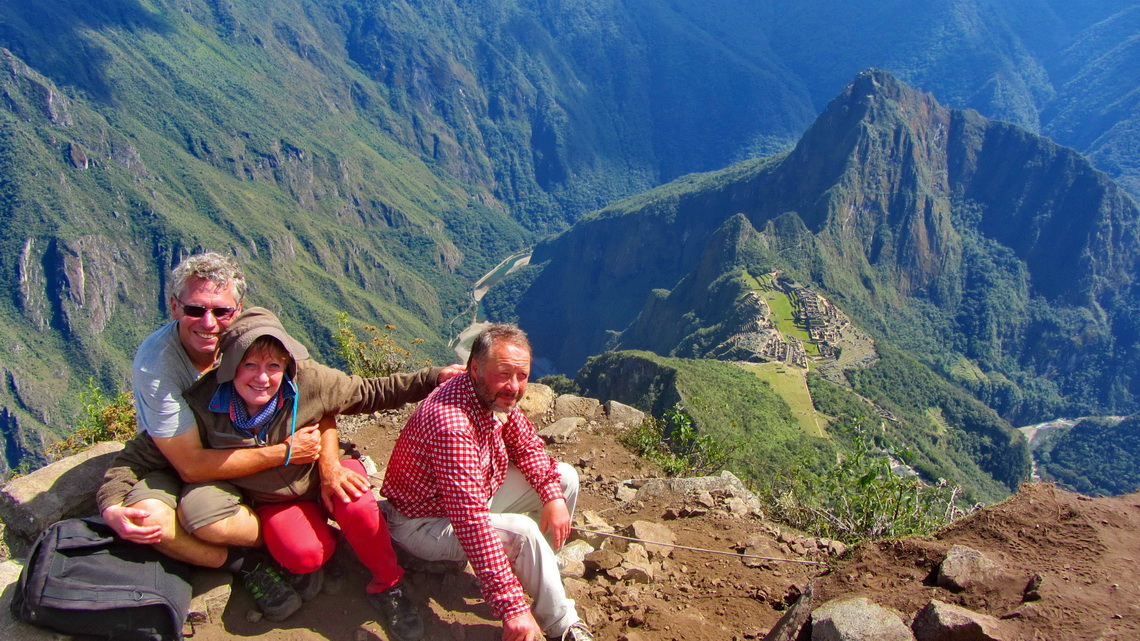 Alfred, Marion and Tommy on the summit of Cerro Machu Picchu with the ancient site and Rio Urubamba in the background