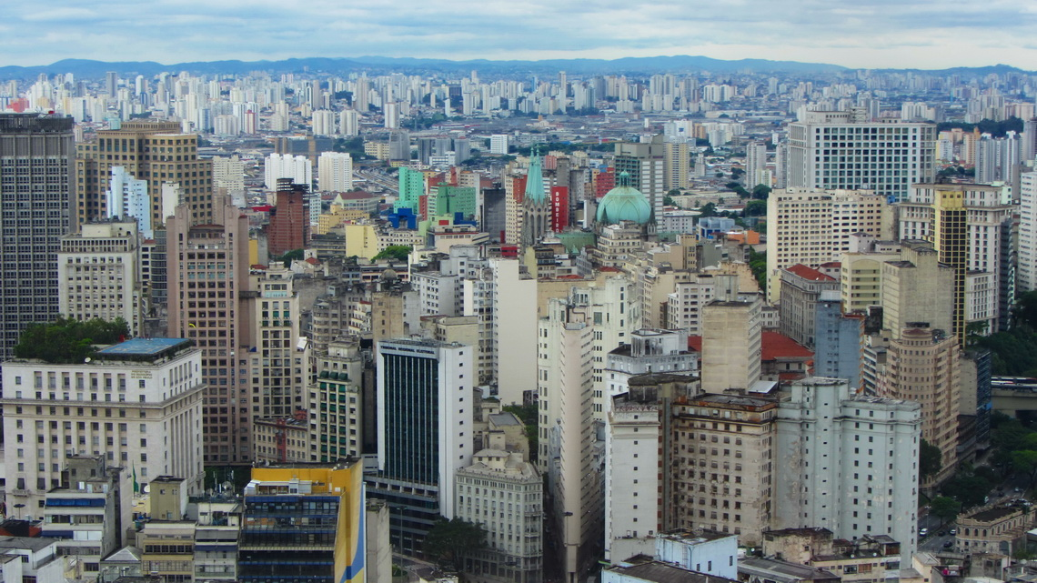 Downtown of Sao Paulo with its cathedral (green roofs in the center of the picture) seen from the top of Edificio Italia