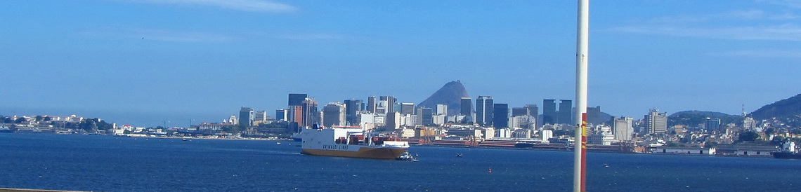 The center of Rio with the Sugar Loaf and a white-orange vessel of Grimaldi