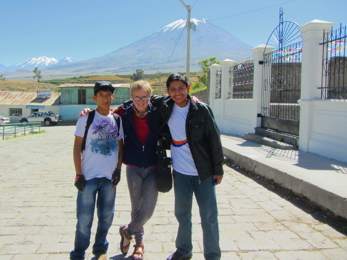 Marion with two boys of Chiguata. Nevado Chachani (left) and Volcan El Misti (center) in the background