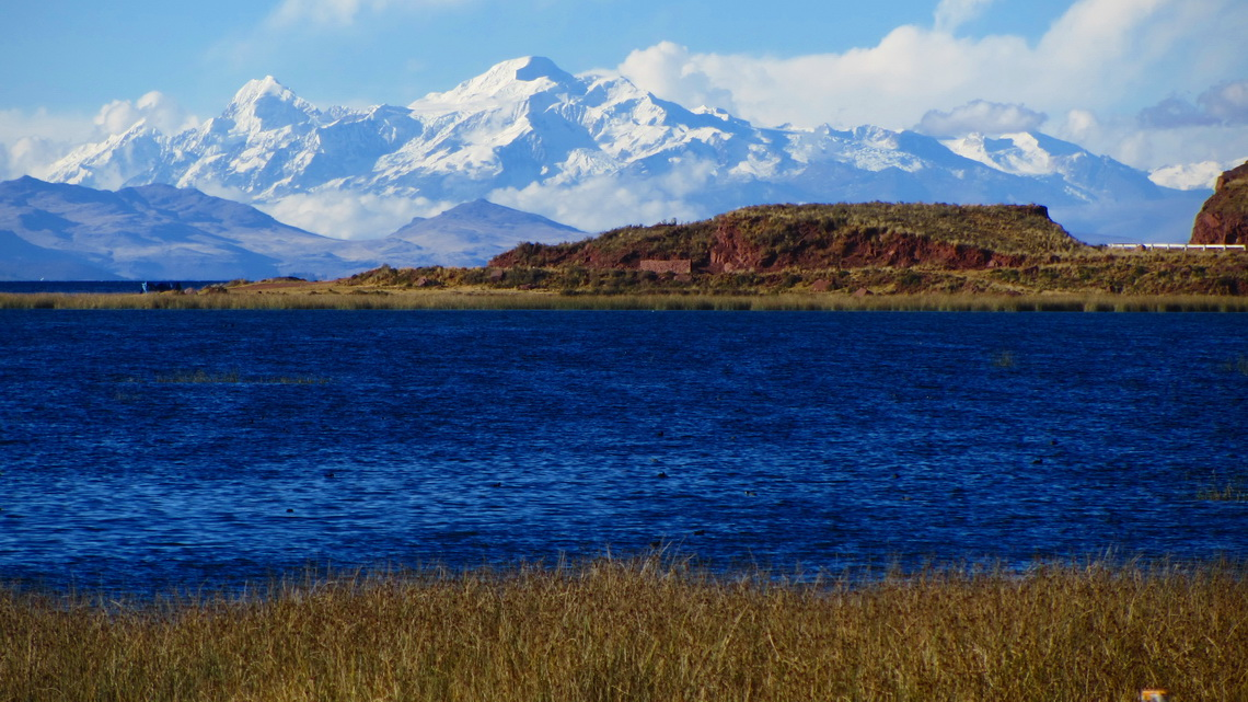 Lake Titicaca with Nevados Illampu and Ancohuma seen from the street to the Peruvian border