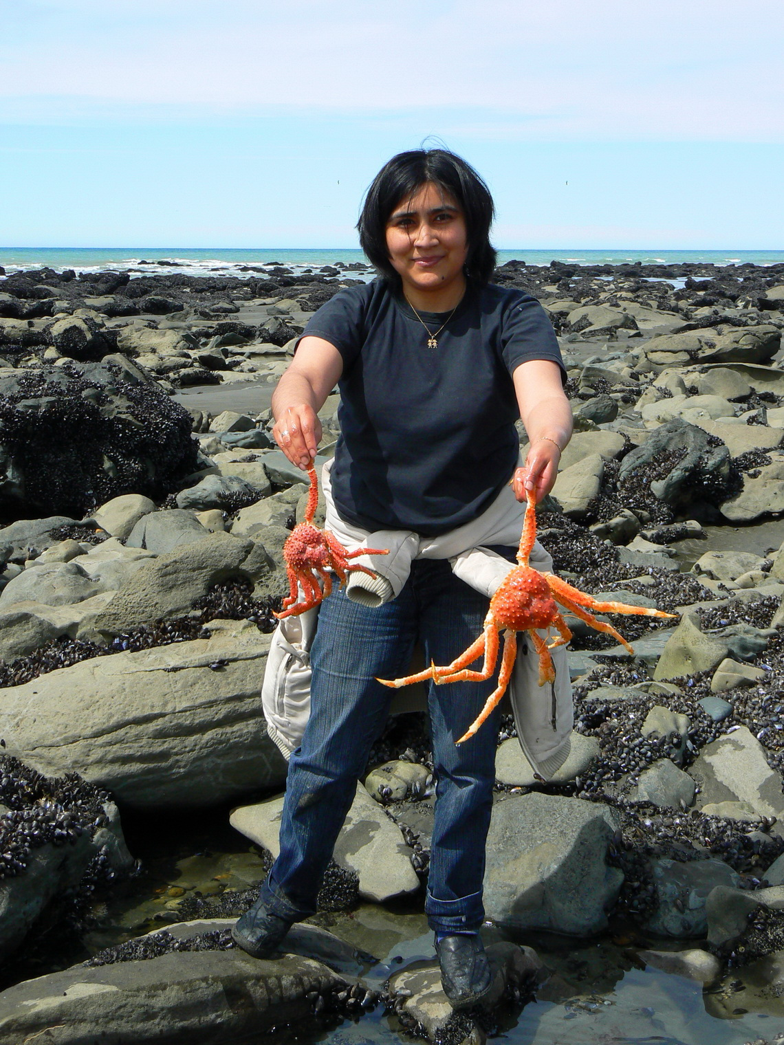 Lucky Argentine girl with two Centollas - Sea Spiders