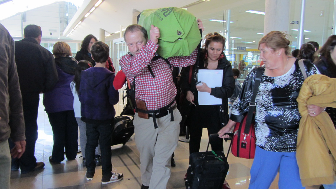 Busy airport of Punta Arenas with Tommy in the center