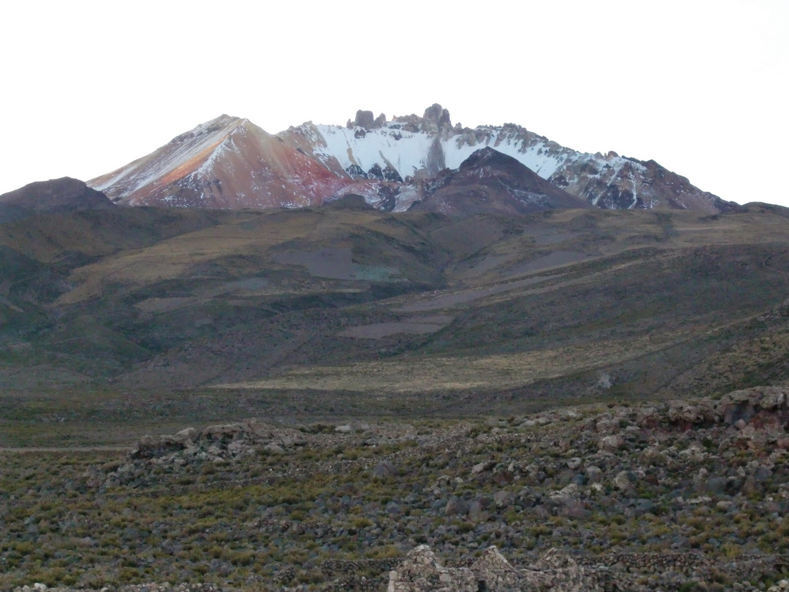 Volcano Tunupa in the last daylight - Accessible is the red brown colored peak on the left side