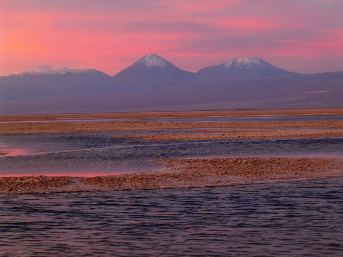 Laguna Chaxi with volcanoes Licancabur and Juriques in the last daylight